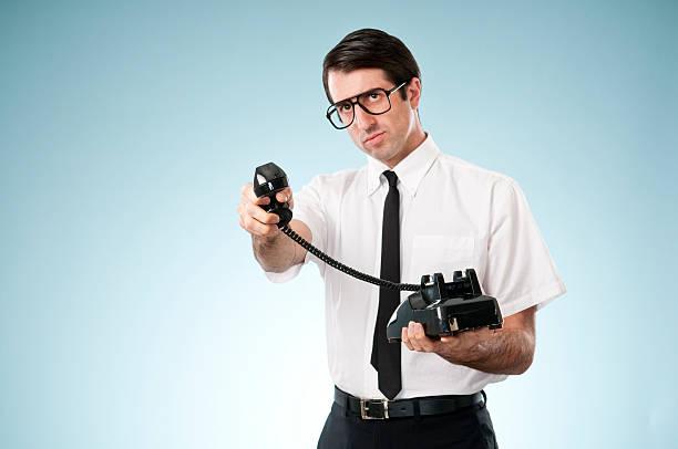 Naiv Büroangestellter mit Vintage-Telefon – Foto