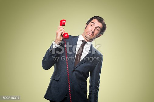 istock Nerdy Office Worker With Vintage Telephone 500216327