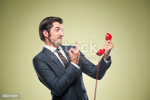 istock Nerdy Office Worker With Vintage Telephone 500216331