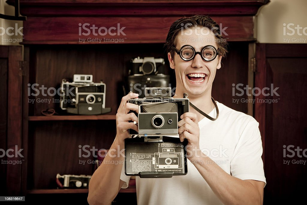 Nerdy Photographer With Old Camera royalty-free stock photo