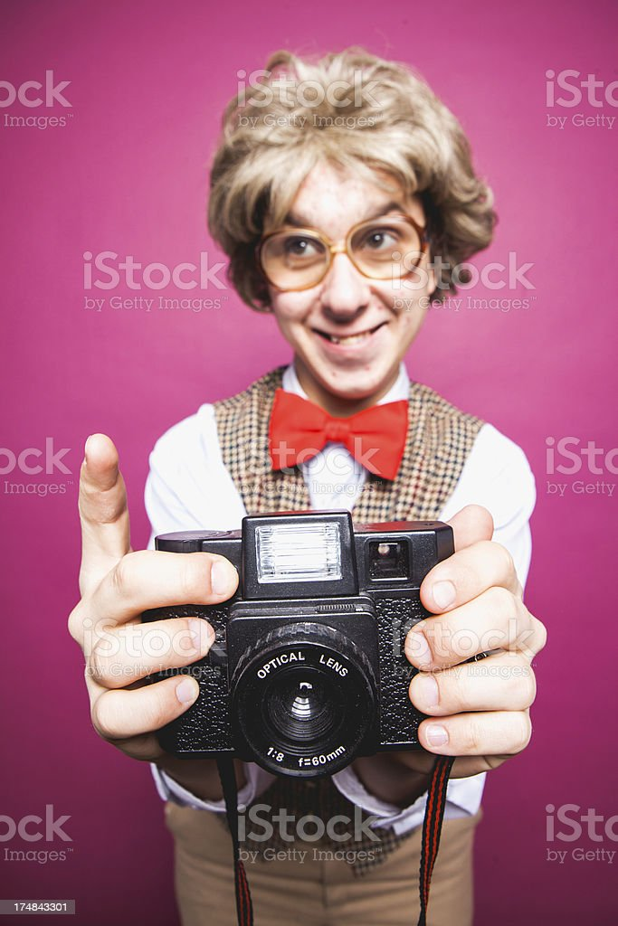 Nerdy Pink Background Photographer Student Young Man Making Silly Face royalty-free stock photo