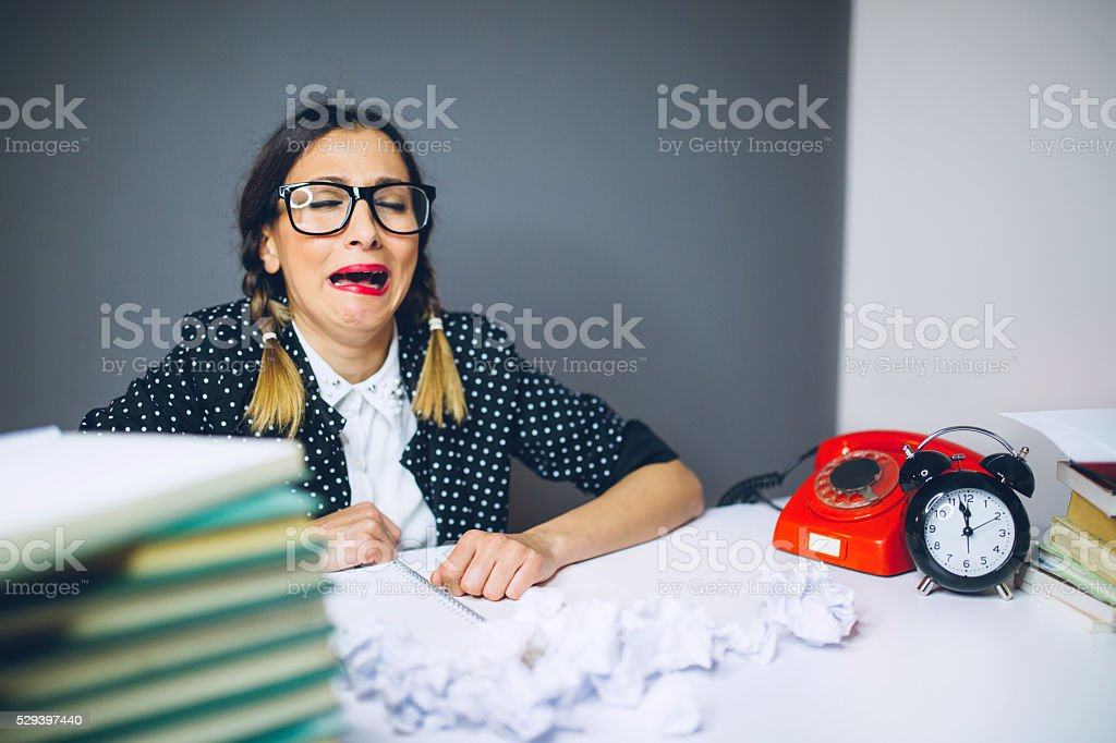 Nerdy secretary having bad day on work stock photo