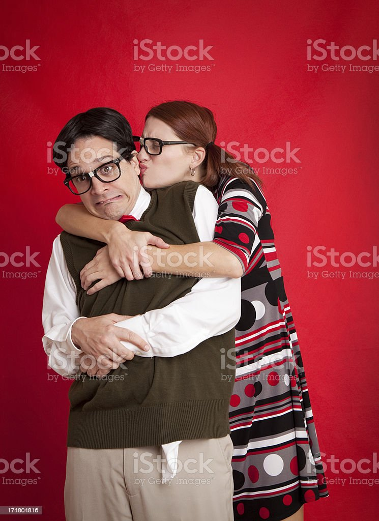 Nerdy Woman Attacking Nerd With An Awkward Kiss stock photo