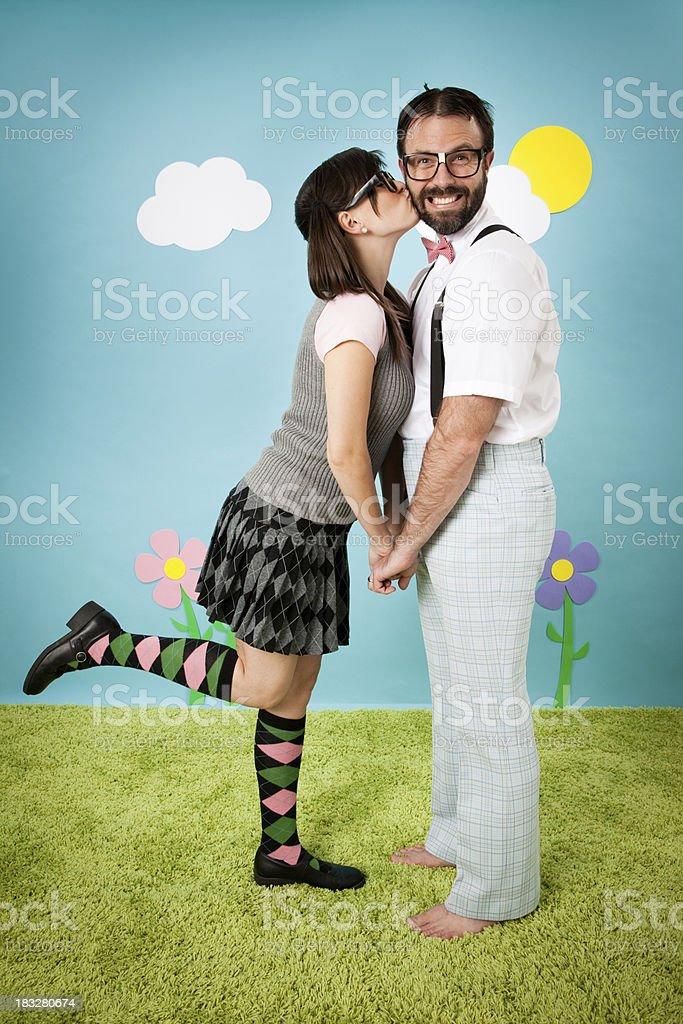 Nerdy Woman Kissing Happy, Dorky Man Outside stock photo