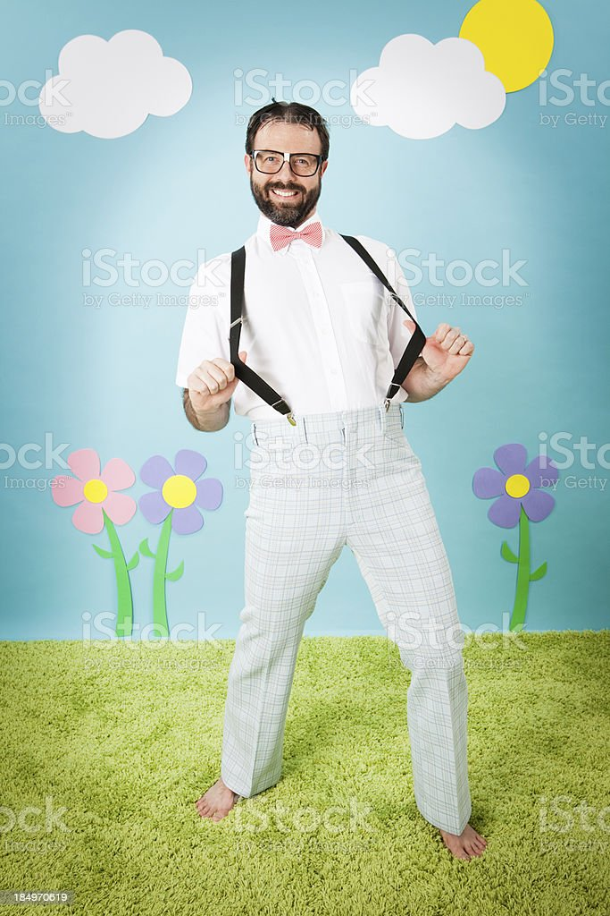 Nerdy Young Man Pulling His Suspenders in Whimsical World royalty-free stock photo