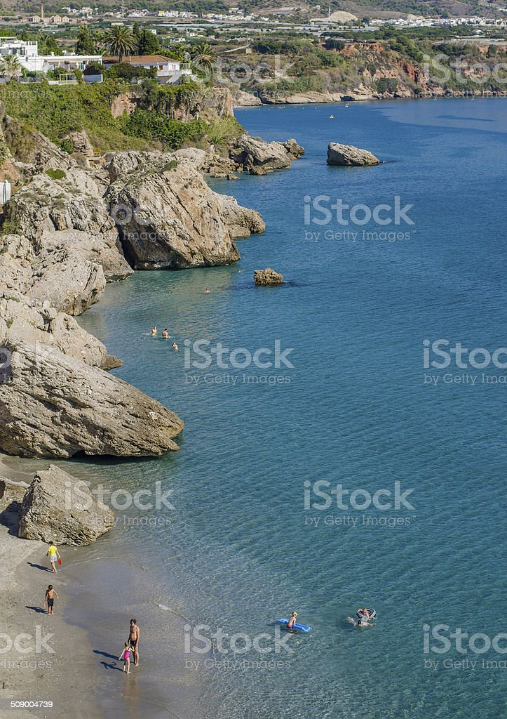 Nerja rocky beach stock photo