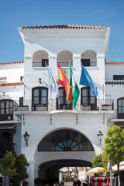 nerja town hall fachada, provincia de málaga, españa. - andalusian flag fotografías e imágenes de stock