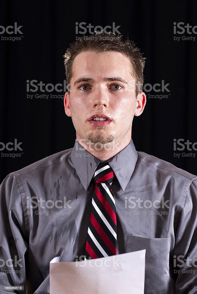Nervous and sweating young male giving a speech stock photo