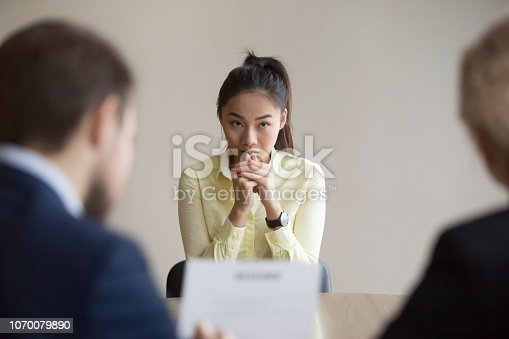 istock Nervous Asian applicant stressed at job interview 1070079890