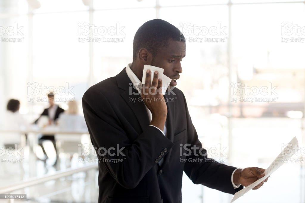 Nervous Black Male Speaker Reading Paper Preparing For ...
