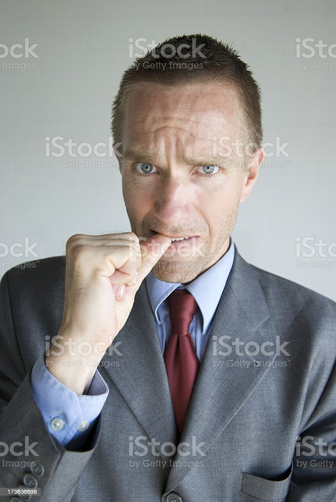 Nervous Businessman Bites Fingernails royalty-free stock photo