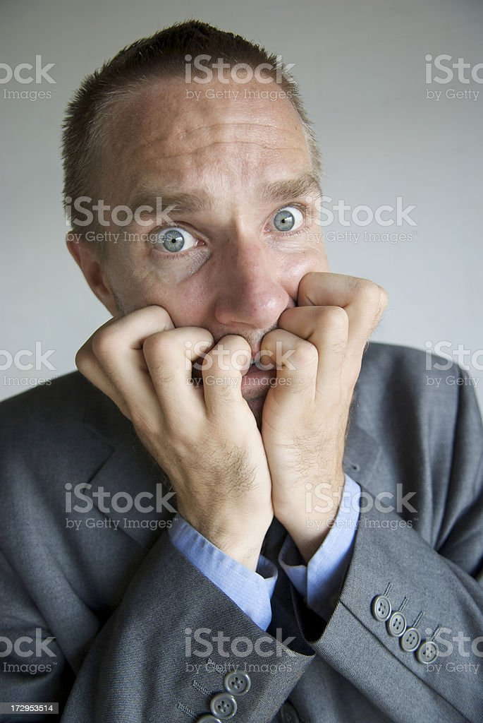 Nervous Businessman Biting his Fingernails Looking Frightened royalty-free stock photo