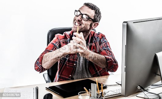 istock nervous businessman expressing his irritation and violence with frustrated hands 625456764