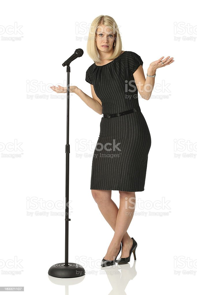 Nervous businesswoman at microphone stock photo