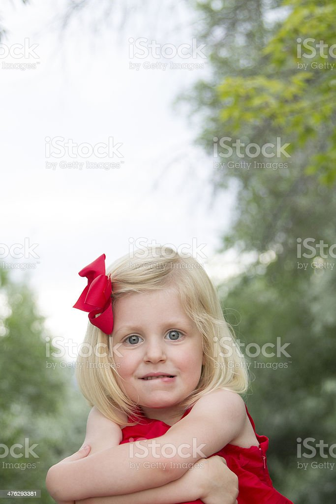 Nervous child biting her lip royalty-free stock photo
