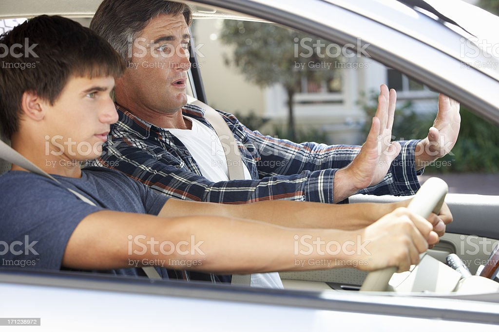 Nervous Father Teaching Teenage Son To Drive stock photo