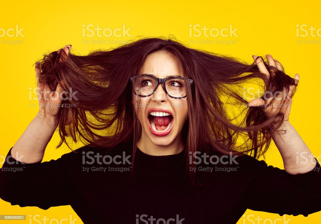 Nervous girl pulling out hair stock photo