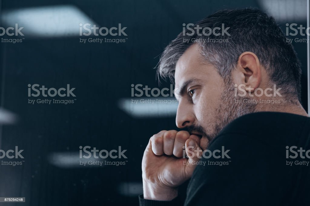 Nervous man in rehab center stock photo