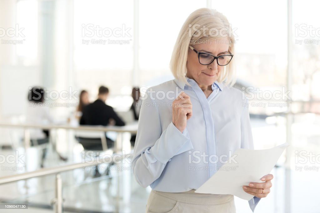 Nervous middle-aged businesswoman feeling stressed afraid waiting for job interview Nervous middle aged old businesswoman feeling scared stressed afraid waiting for job interview, worried mature senior applicant or speaker reading papers preparing for public speaking fear concept Businesswoman Stock Photo