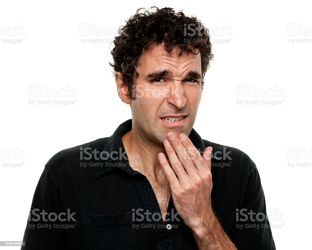Nervous Uncertain Young Man Grimacing stock photo
