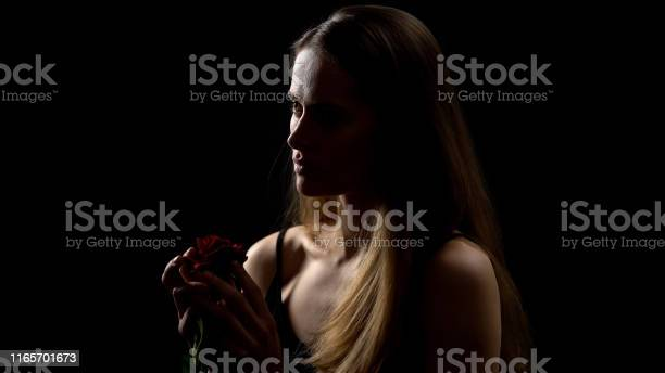 Nervous woman holding red rose from exboyfriend isolated on black picture id1165701673?b=1&k=6&m=1165701673&s=612x612&h=aurepyudzks jrwklzwahslwrtpdb1xqxpgcgkeo2fy=
