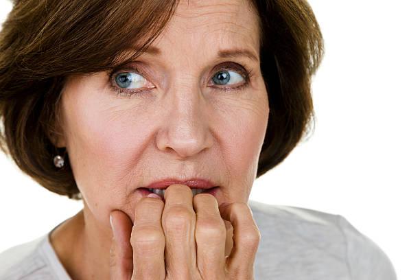 nervous woman - mature woman fever on white bildbanksfoton och bilder