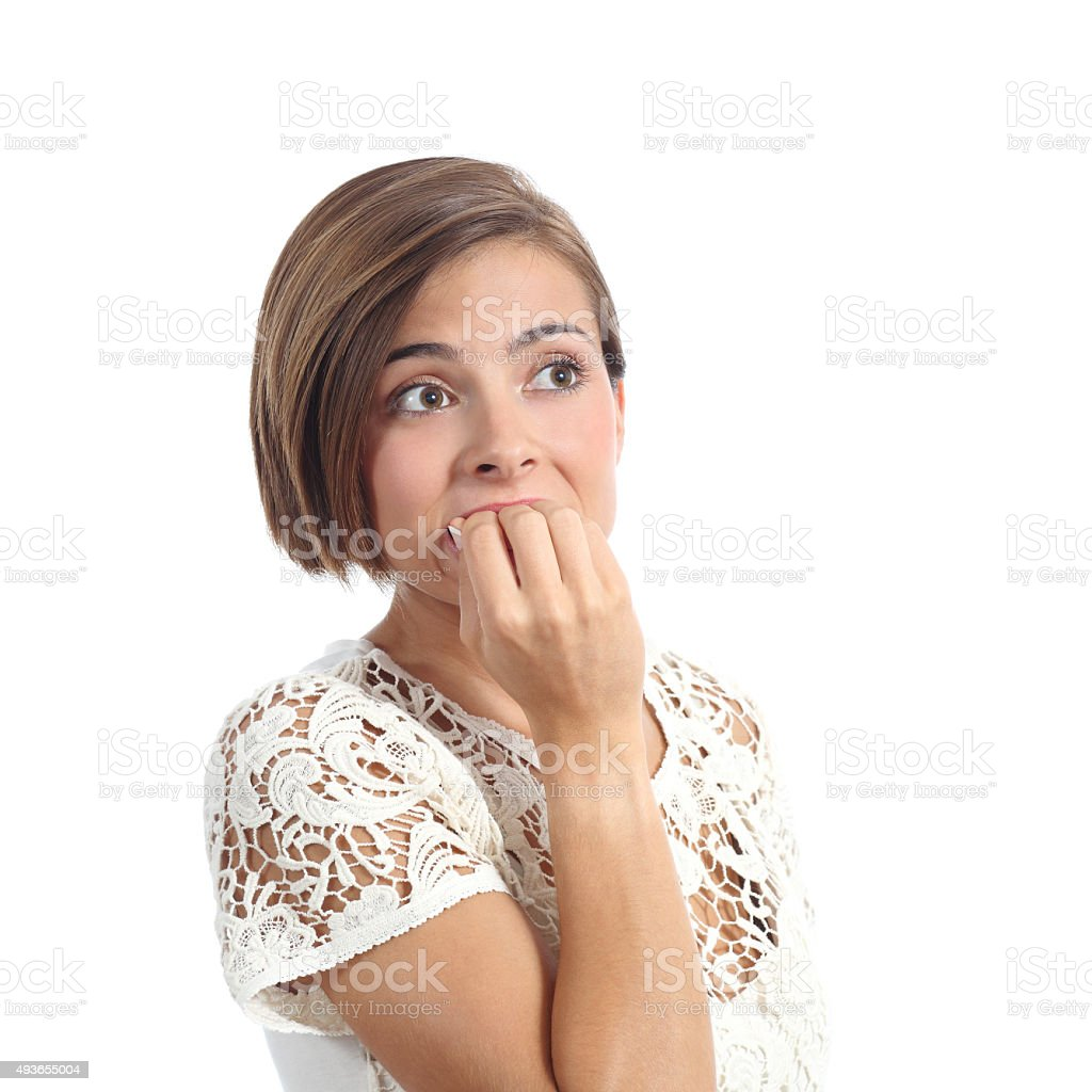 Nervous worried woman biting nails stock photo