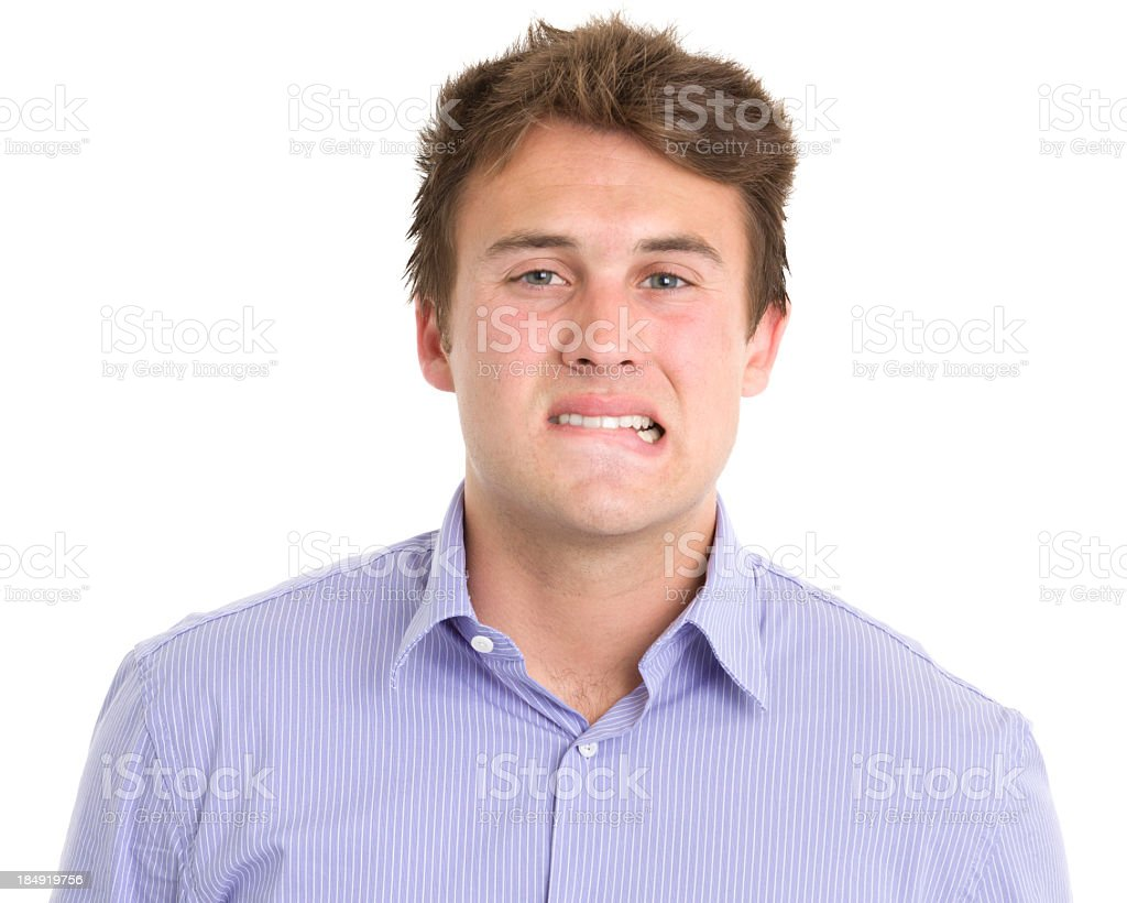 Nervous Young Man Biting Lip stock photo