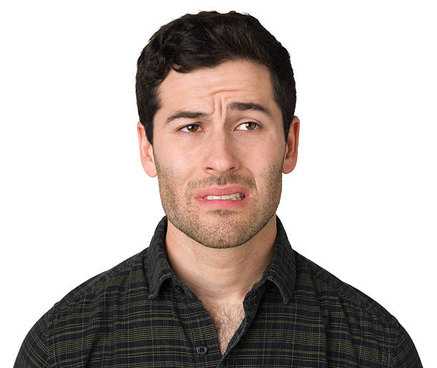Nervous Young Man Portrait of a young caucasian man on a white background. embarrassment stock pictures, royalty-free photos & images