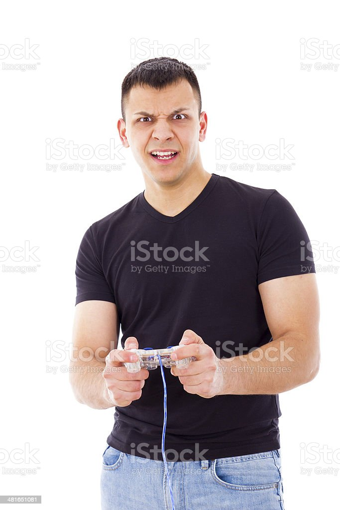 nervous young man playing video game with joystick royalty-free stock photo