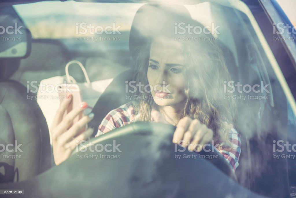 A nervous young woman in the car stock photo