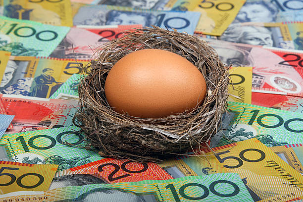 Nest Egg in Australian Cash Savings nest egg concept with Australian dollar notes aa shallow depth of field. Click to see more... nest egg stock pictures, royalty-free photos & images