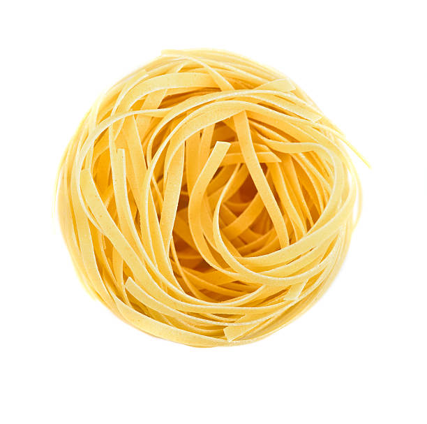 Nest pasta View from top Nest pasta. View from top isolated on white background uncooked pasta stock pictures, royalty-free photos & images