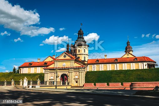 Nesvizh, Belarus - July 31, 2013: Nesvizh Castle with Picturesque Blue Sky Background at sunny summer day.: Nesvizh Castle with Picturesque Blue Sky Background at sunny summer day.