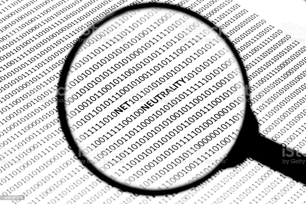 A net neutrality concept image consisting of a magnifying glass, digital code and the word 'NET NEUTRALITY'. stock photo