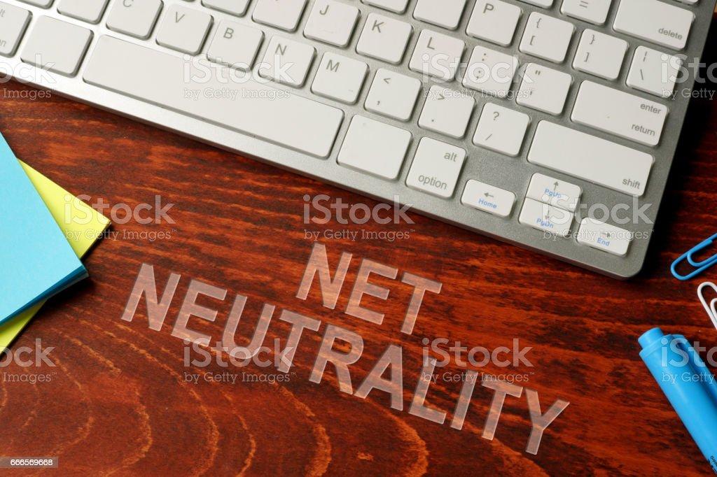 Net neutrality written on a wooden surface. Neutral internet concept. stock photo