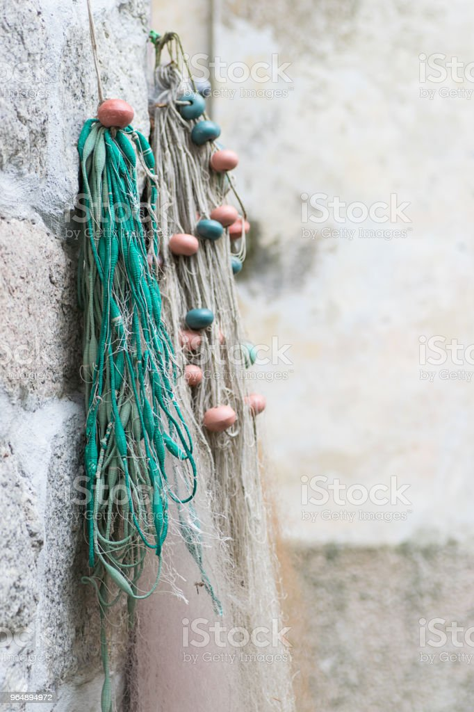 Net of fishermen on the wall in a small Italian fishing village royalty-free stock photo