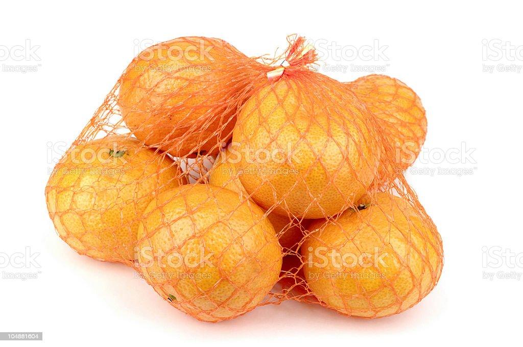Net Of Satsuma Oranges On White Background stock photo