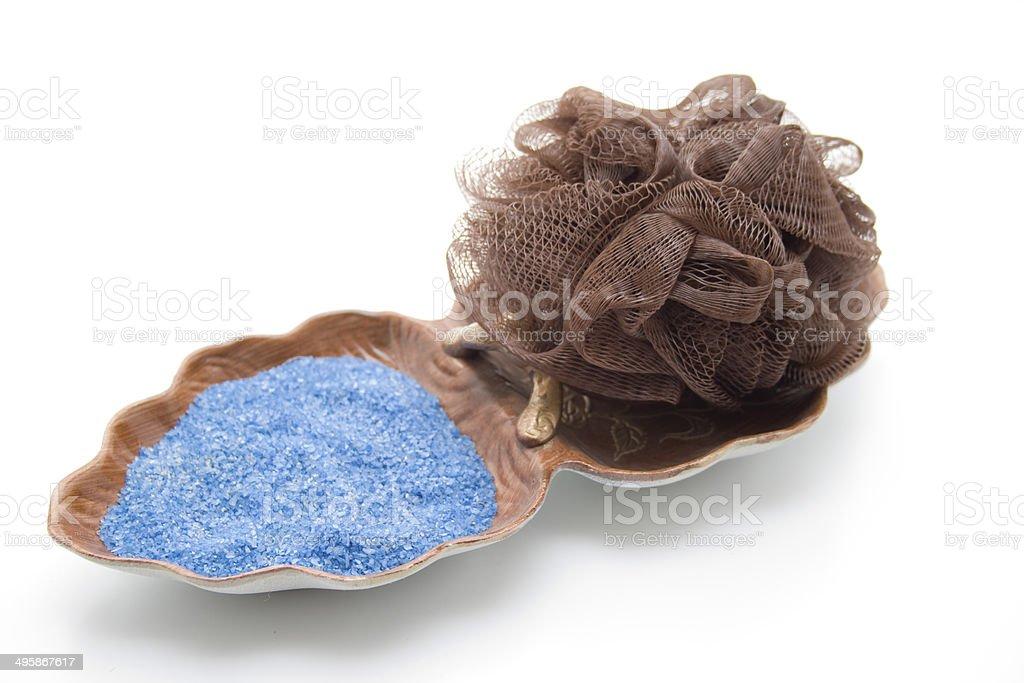 Net sponge with blue sand stock photo