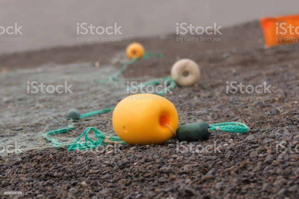 Net with floats on the black Chukotka coast during the spawning sockeye salmon stock photo