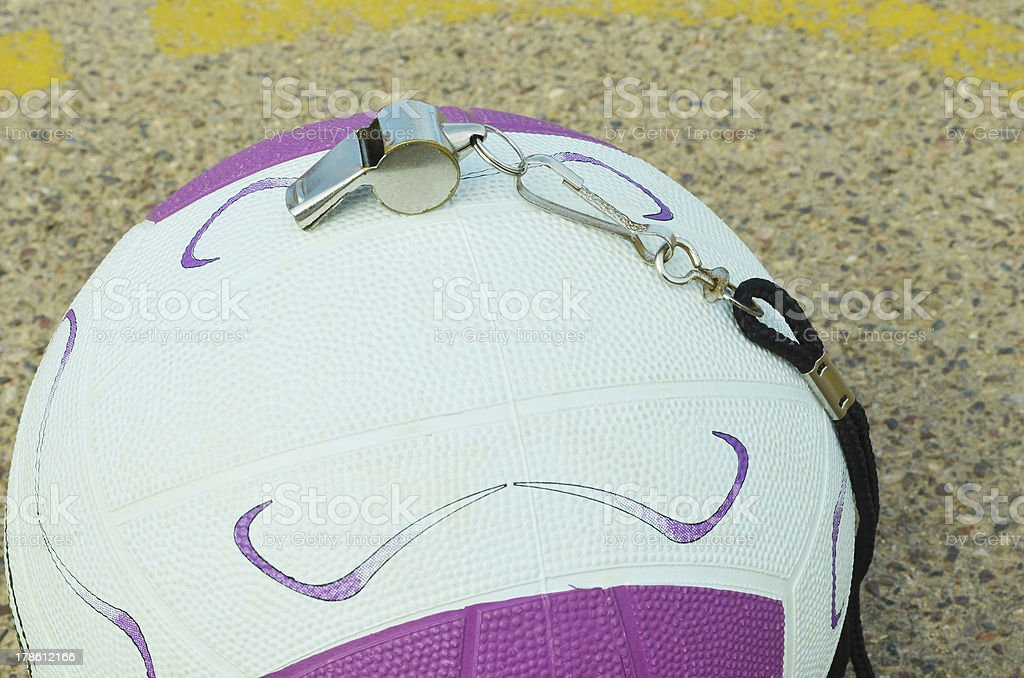 Netball and whistle on a court royalty-free stock photo