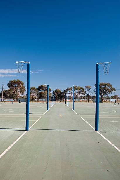 netball courts and rings - netball stockfoto's en -beelden