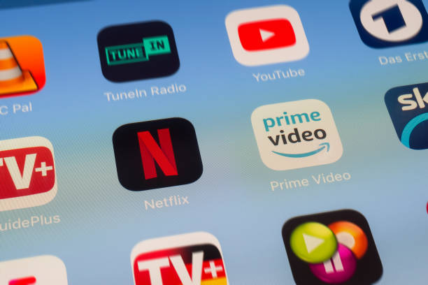 Netflix, Amazon Prime and other video streaming Apps on iPad screen London, UK - June 01 2018: The icons of Netflix, Amazon Prime Video, TvGuidePlus, TVCatchup, VLC Player, TuneIn Radio, YouTube and Das Erste apps on the screen of an iPad. netflix stock pictures, royalty-free photos & images