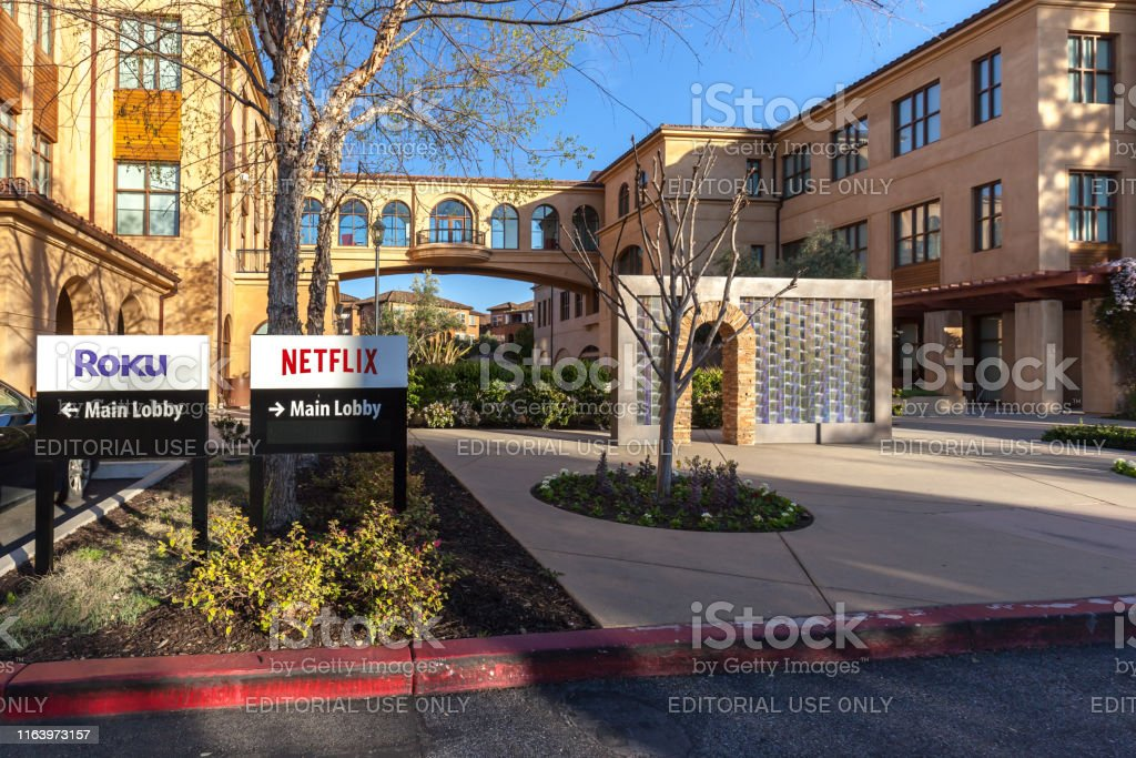 Netflix and Roku signs at headquarters in Los Gatos, California. Los Gatos, California, USA - March 29, 2018: Netflix and Roku signs at headquarters in Los Gatos, California. Arts Culture and Entertainment Stock Photo