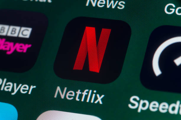 Netflix, BBC iPlayer, News, Speedtest and other Apps on iPhone screen - foto stock