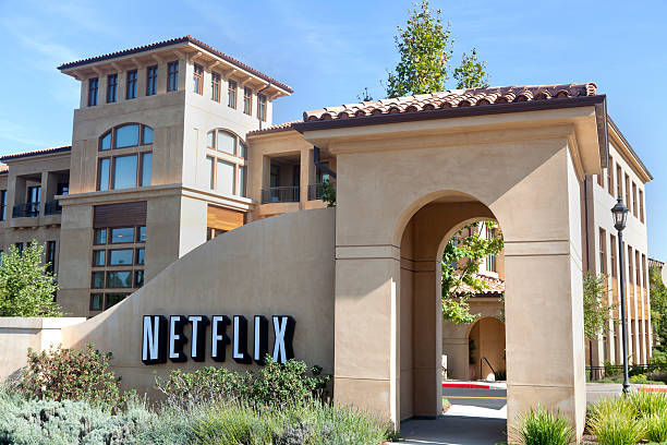 Netflix Headquarters Los Gatos, California, USA - October 21, 2011: Headquarters of internet movie pioneer Netflix,  located at 100 Winchester Circle in Los Gatos, CA. The world-renown company was started in 1997, offering it's no late-fee, subscription based DVD-by-mail service which has grown to a collection of over 100,000 movie titles and over 23 million subscribers. In 2010, Netflix reached a deal with Hollywood movie companies allowing it to offer on-demand internet streaming. netflix stock pictures, royalty-free photos & images