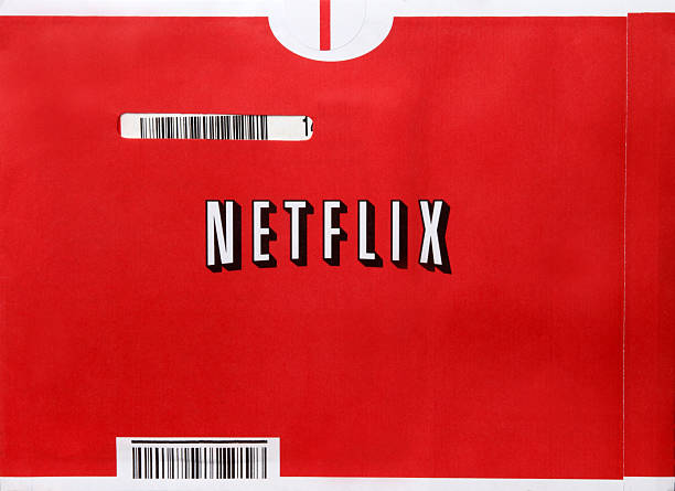 Netflix Kingston, New York, USA - October 27, 2011: A photograph of a Netflix mailer envelope.  With more than 25 million members worldwide, Netflix, Inc. is the world\'s leading Internet subscription service for movies and TV shows. Netflix members can have DVDs sent to them in the mail, or instantly watch movies and TV episodes streaming over the Internet to computers and TVs. netflix stock pictures, royalty-free photos & images
