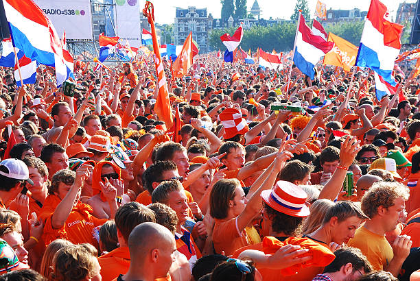 Netherlands football fans. Amsterdam, Netherlands- June 09, 2010: Thousands of Holland football fans watching the national team playing a World Cup match on a large screen near the Rijksmuseum in Amsterdam. museumplein stock pictures, royalty-free photos & images