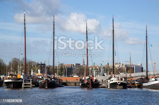Historic ships docked at the Harbour Museum Society (Vereniging Museumhaven) in Amsterdam, providing an insight into the country's maritime history.