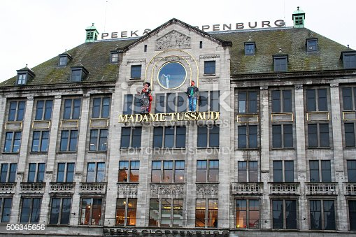 Amsterdam, Netherlands - March 26, 2009: The Madame Tussauds wax museum on Dam Square, located in the Peek & Clopenburg building. The museum is a popular tourist attraction in Amsterdam, housing the likenesses of famous people from around the world.